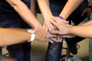 hands_team_prayer