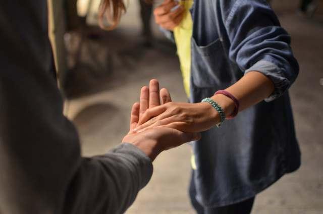reach_holding_hands
